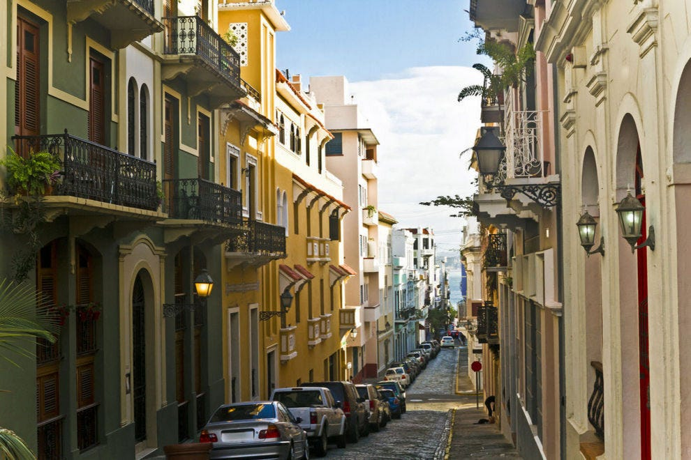 Colorful buildings line blue cobblestone streets in the heart of Old San Juan