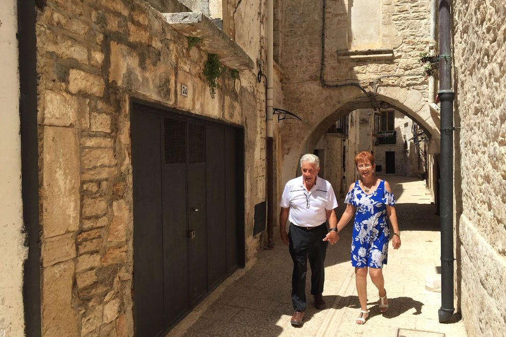 Dominick and Lorraine Petrulli in Dominick's ancestral town of Bitetto, Bari, Italy on a genealogy discovery trip with European Focus Private Tours