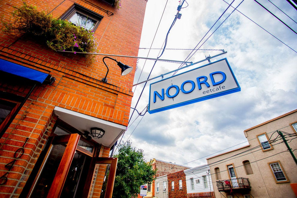 Guests of Noord enjoy rustic, traditional meals in a chic and modern atmosphere