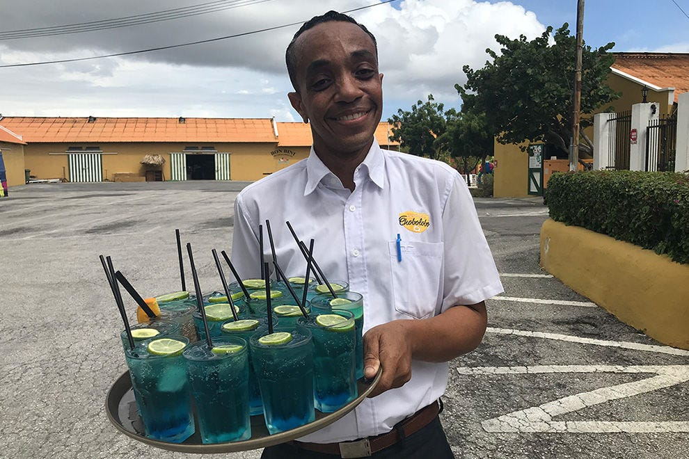 The tour at Curaçao Liqueur Distillery starts with a cocktail
