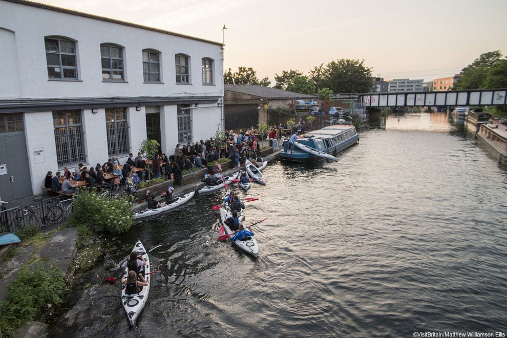 Rowers gather by the scenic River Thames in Richmond