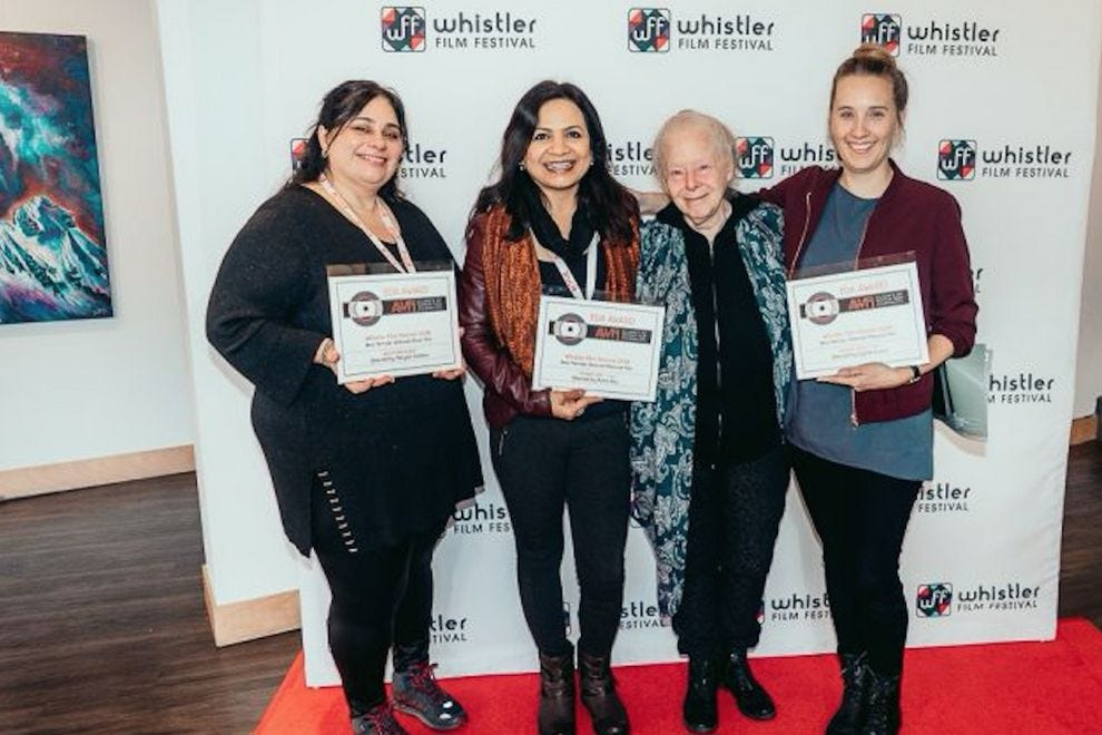 AWFJ members Marina Antunes and Jennifer Merin present EDA Awards to filmmakers Rama Rau and Sophie Dupuis at the Whistler Film Festival