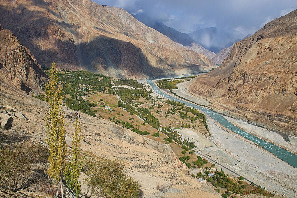 The Balti village of Turtuk, once Pakistan, now part of Ladakh, India, viewed in autumn under the Karakoram Range and Shyok River