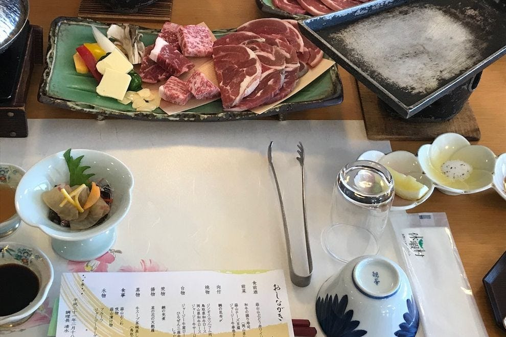 Shabu-shabu involves swirling sliced cuts of beef and vegetables in boiling water
