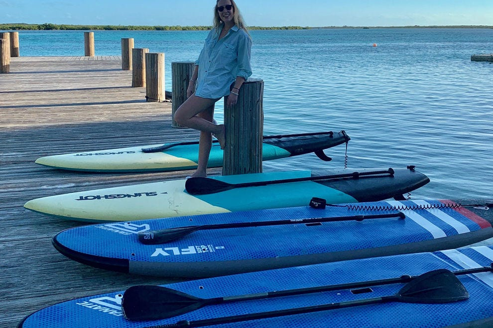 On-site paddle boarding is just one of the activities offered at the resort; paddle across the bay into the mangroves to see a variety of marine life