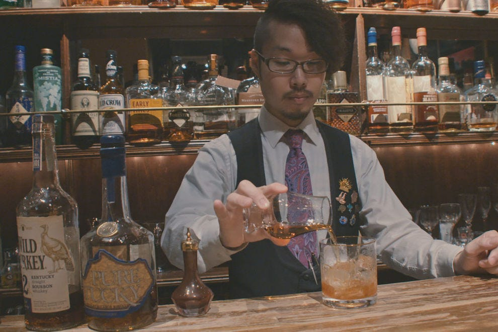 A bartender in Tokyo making an Old Fashioned