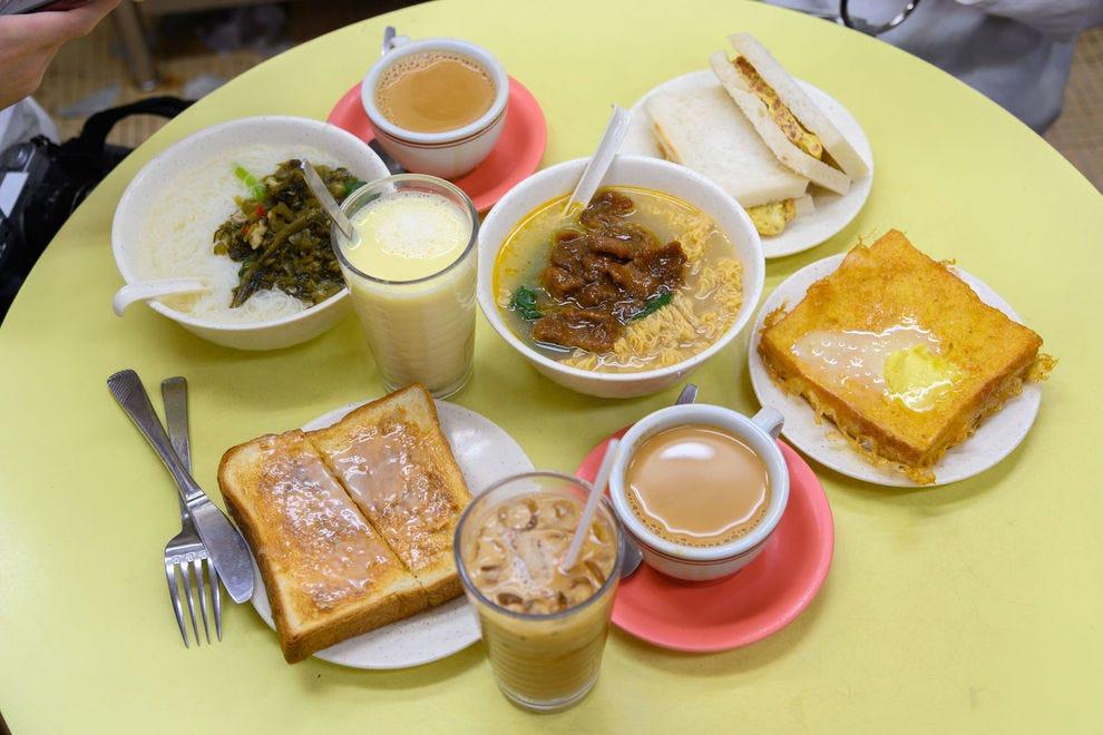 """Enjoy a casual breakfast among locals at a <em>cha chaan teng</em>""""><span class="""