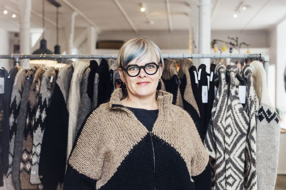 Sissal Kristiansen, co-owner of Ullvoruhusid, showing off one of her stylish jackets