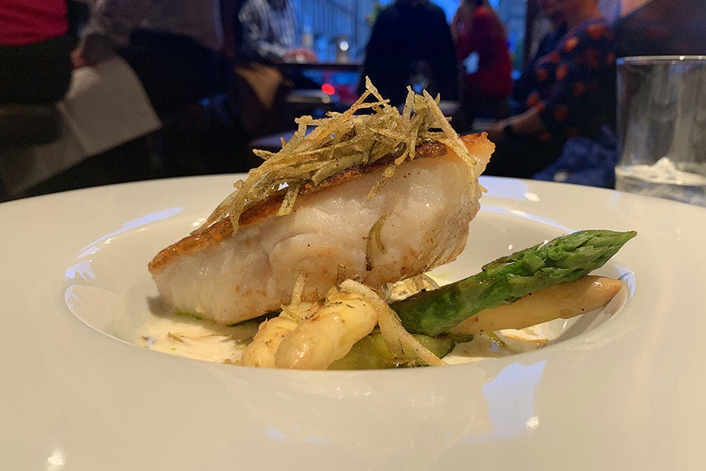 Crabshakk's cod cooked in buttermilk with asparagus, leeks and crisp shoestring potatoes