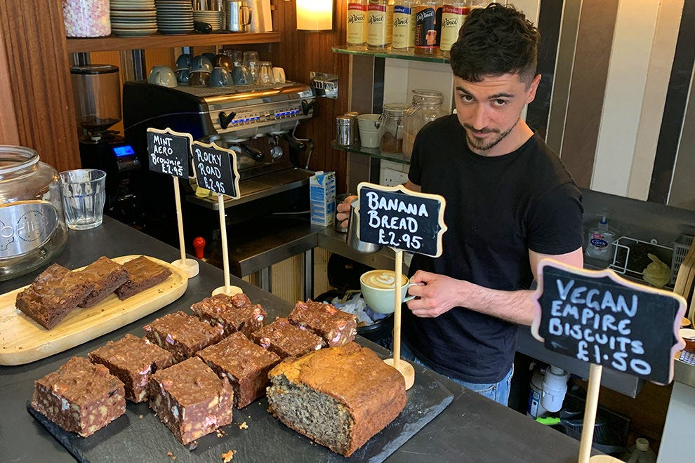 Barista Vince Polo with the house-baked treats and delicious lunches at cool little cafe Seb & Mili