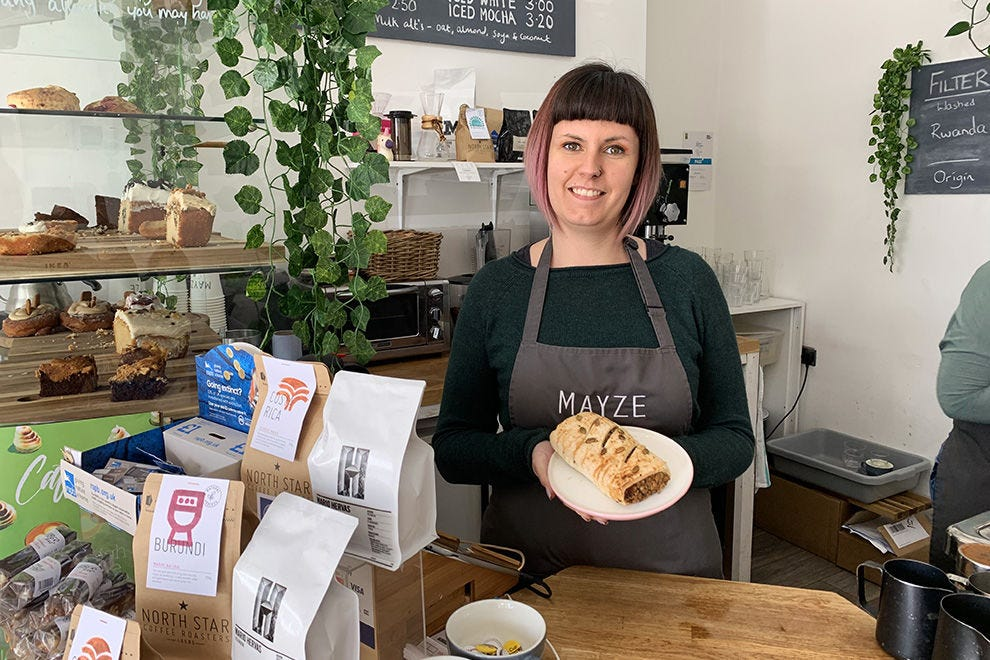 Gillian McIntyre, co-owner of Mayze with a vegan haggis roll (a best seller)
