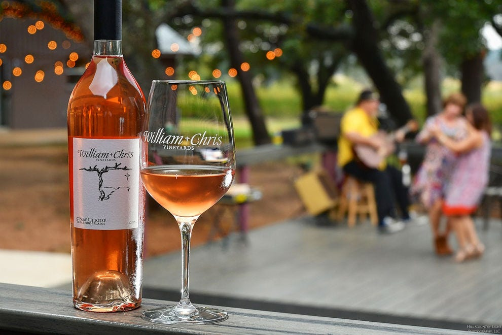 Wine lovers enjoy sprawling patio spaces and tasty pours at Wine Country spots like William Chris Vineyards