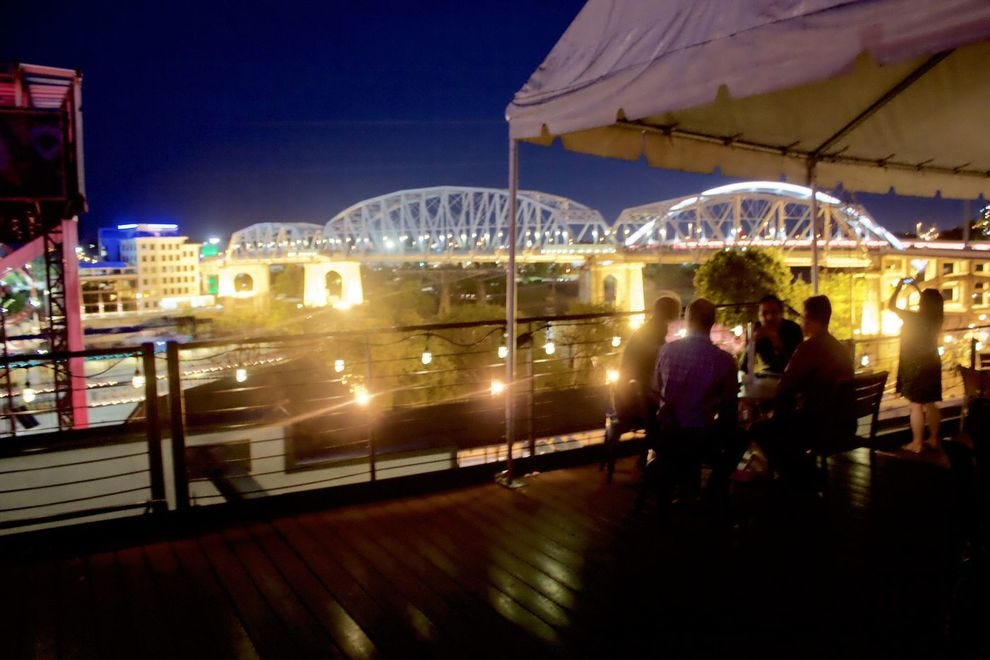 Acme Feed & Seed Rooftop at night