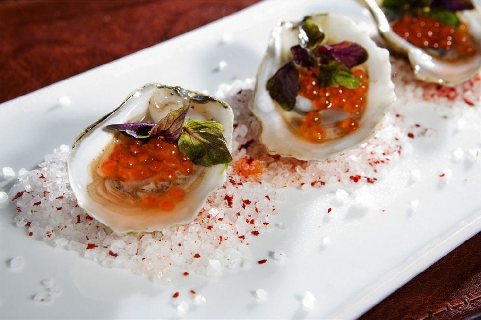 B&O American Brasserie serves market oysters with gin mignonette and Tabasco-horseradish sorbet, among other ways