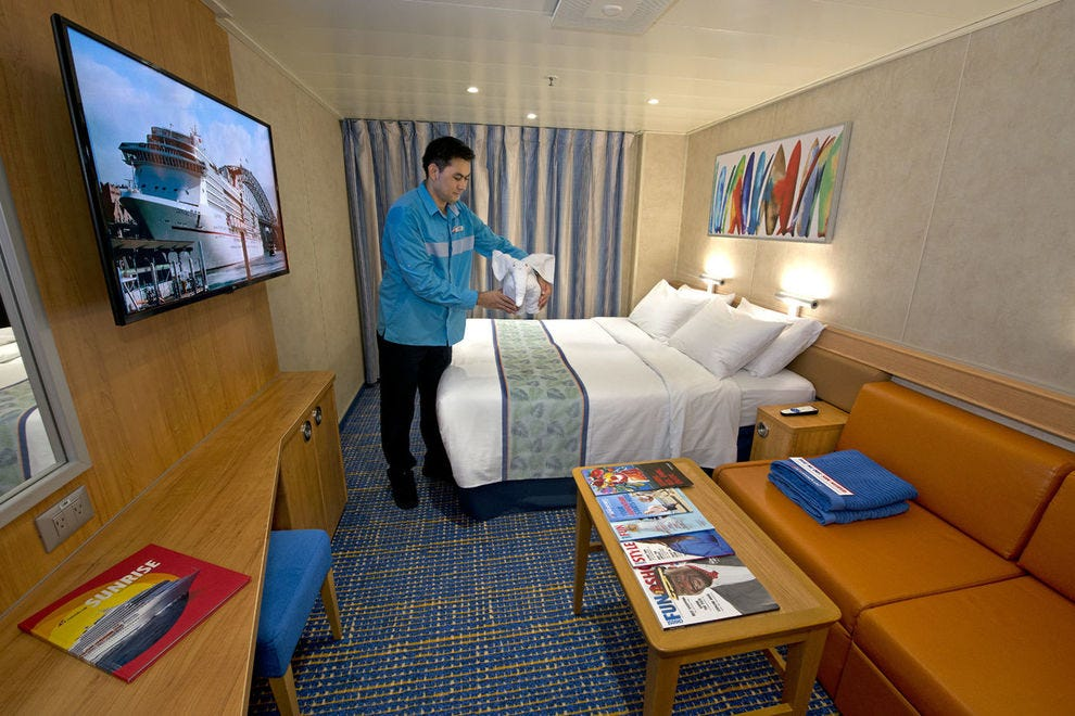 Bright oceanview stateroom on <em>Carnival Radiance</em> is a cheery place to return after touring