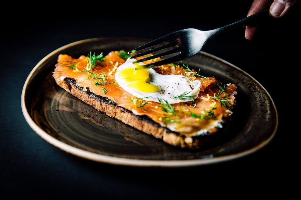 House-cured gravlax tartine, with grilled rye bread, horseradish cream, quail egg, dill and lemon at Workshop Kitchen + Bar