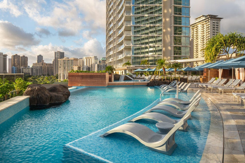 Guests of winning hotel enjoy an infinity pool on the eighth floor rooftop