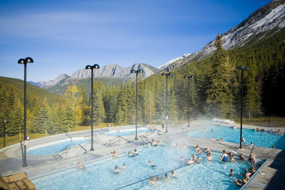 Feel your cares fade away while swimming at Miette Hot Springs in Jasper National Park