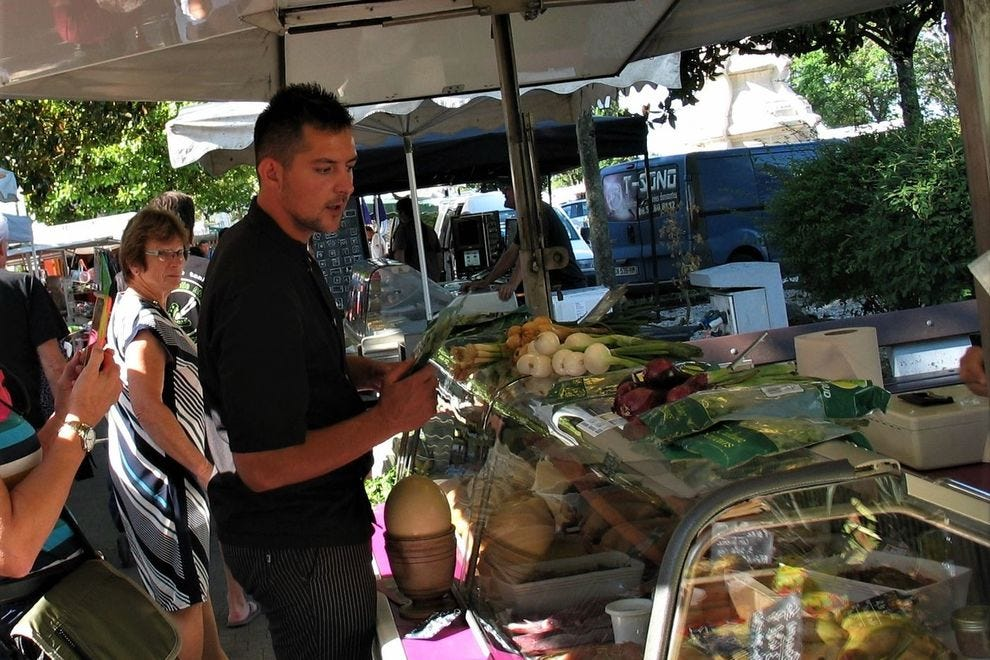 """Shadowing <em>Tango</em>'s private chef, Pierre, at the Blaye fresh market""""><span class="""