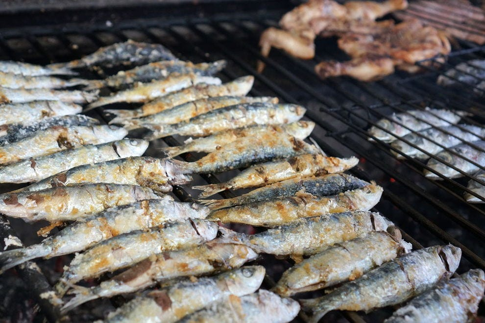Fresh, grilled sardines rule the culinary scene during the summer season