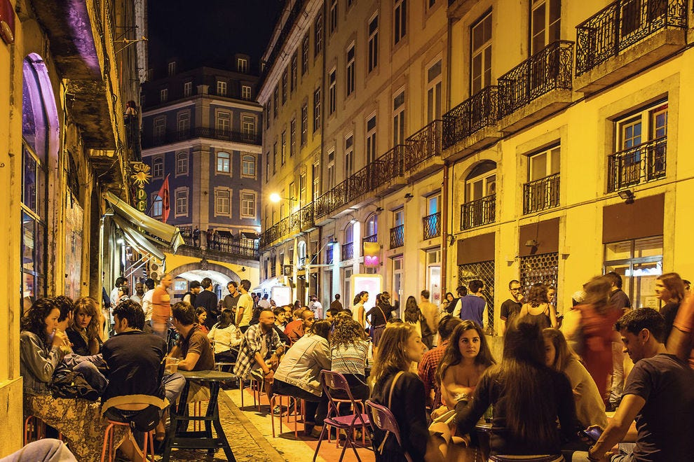The narrow streets of Lisbon come alive at night with food, music and fun