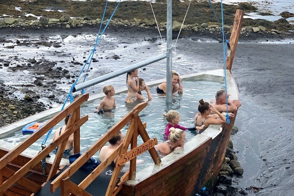 A Viking ship-style hot tub on the beach