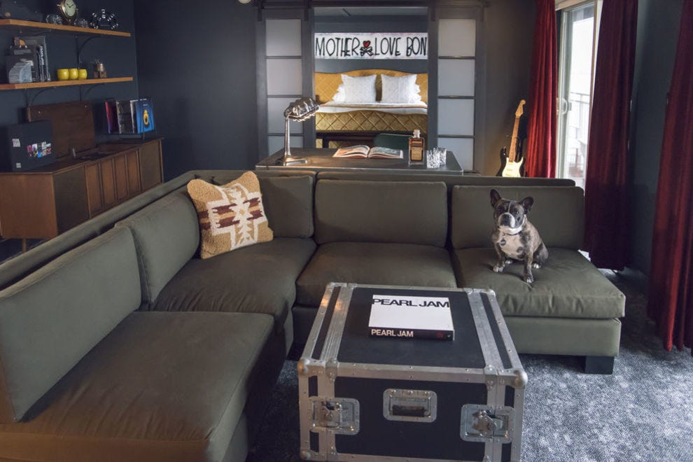 In this theme suite, The Edgewater partnered with Pearl Jam and its fans to create this room's industrial, grunge-inspired design with fun touches like authentic band art posters