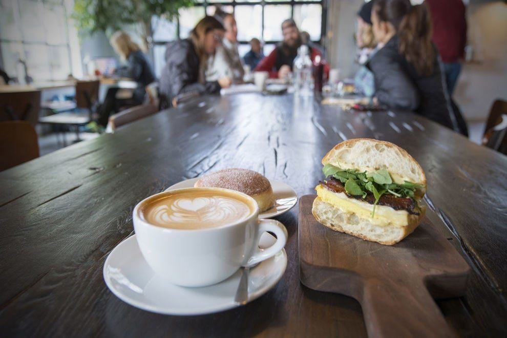 A hand-crafted coffee and an egg soufflé sandwich from Fox in the Snow Cafe
