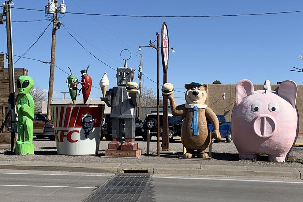 A cast of giant characters lines up across the street from Sparky's calling attention to the burger joint