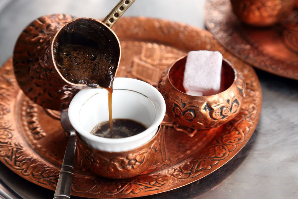 Turkish coffee being poured from cezve