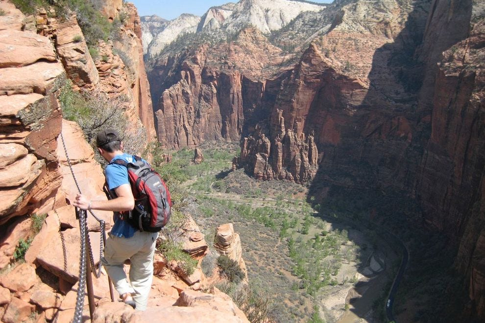 A hiker climbs down from the Angels Landing summit