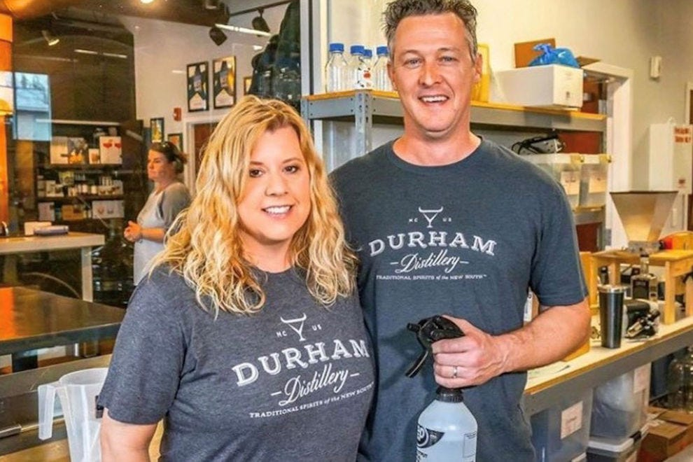 Melissa and Lee Katrincic of Durham Distillery holding their hand sanitizer