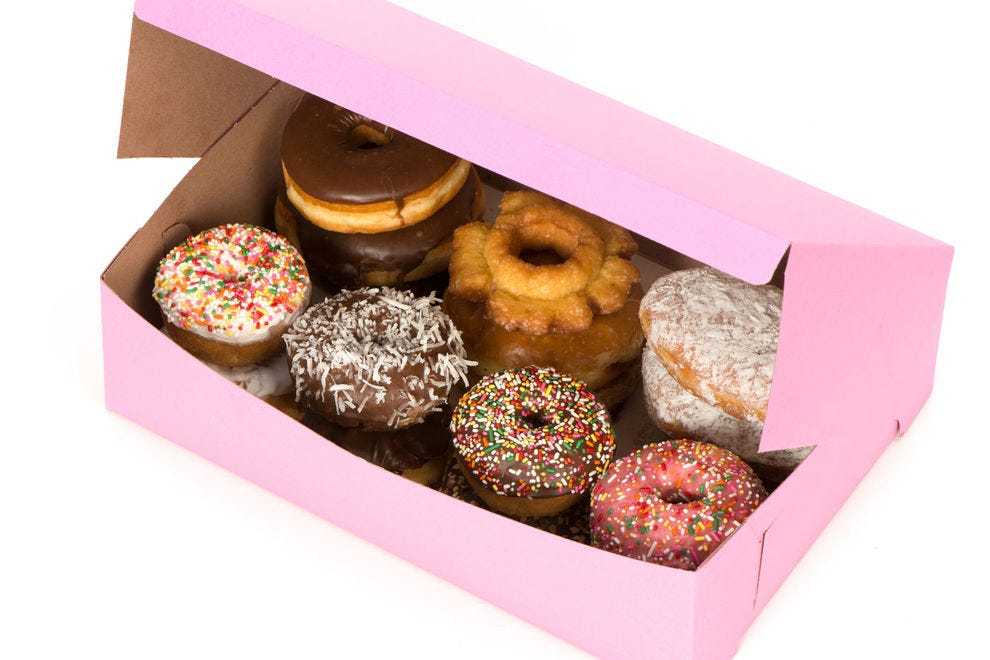 Why do local doughnut shops use pink boxes?