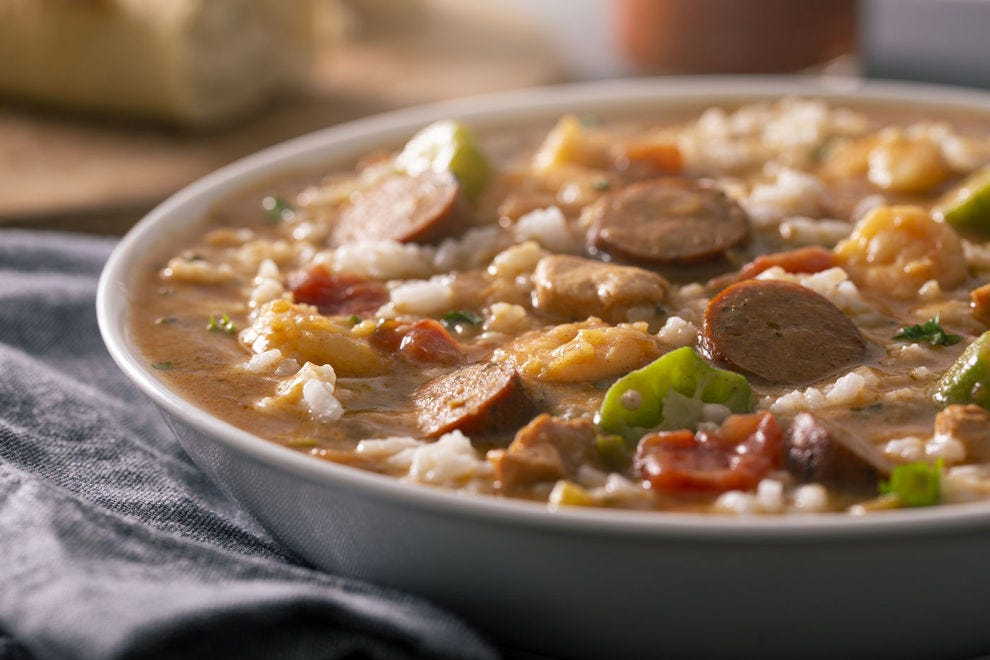 Creole gumbo is typically a tomato-based stew, while Cajun gumbo is made with a dark roux