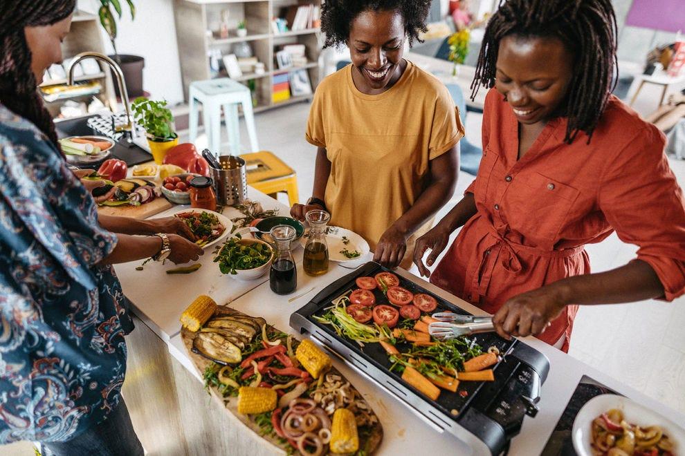 Women making food together