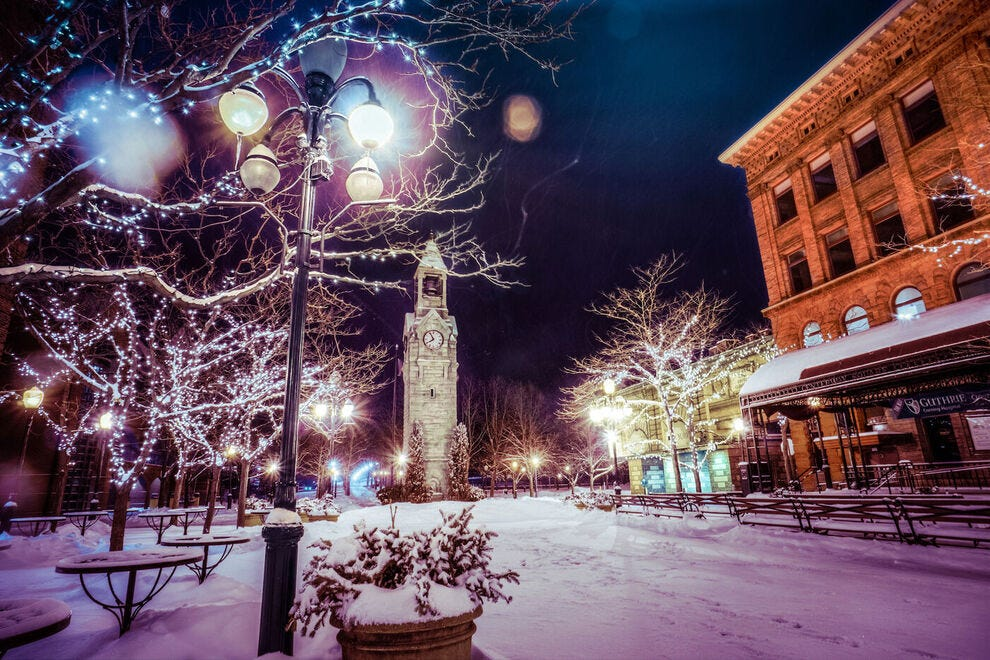 This public square in Corning, New York is known for its clock tower and charming street lamps