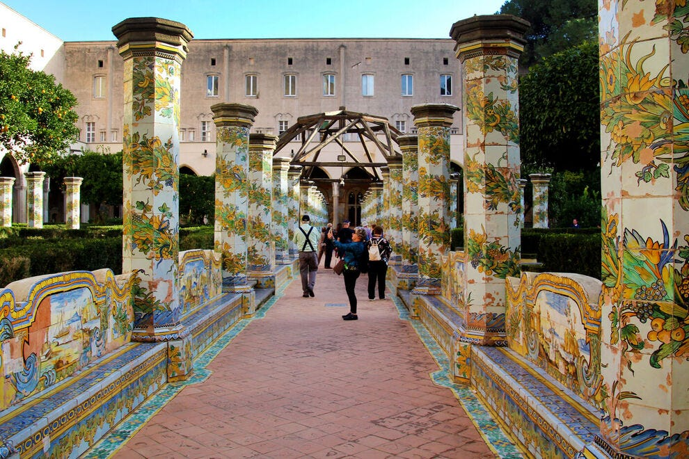 Tiled columns and benches in the gardens of the Santa Chiara cloister in Naples