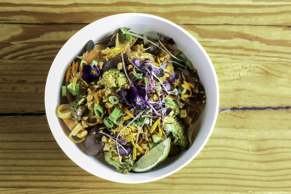 The Fiction Kitchen serves dishes like the popular peanut noodle bowl