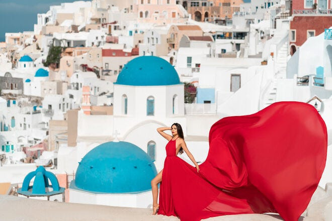 On your next vacation, book a gorgeous flying dress photo shoot