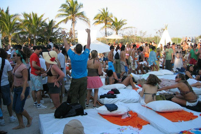 Patrons enjoy a festive atmosphere at  Nikki Beach, Miami.