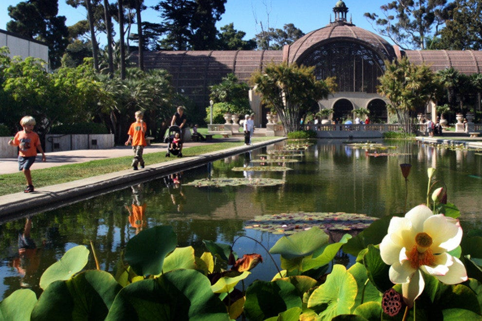 A family enjoys a stroll through San Diego's beautiful Balboa Park.